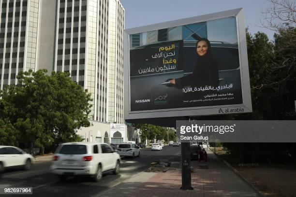 An advertising billboard for Japanese automaker Nissan shows a woman about to get into a car on the day women are legally allowed to drive in Saudi...