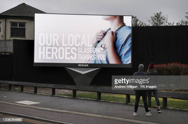 An advertising billboard in Glasgow displays a message in support of the NHS In a gesture of thanks to the frontline healthcare heroes everyone...