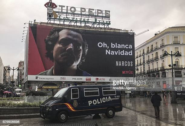 An advertising board of the tv series Narcos which is about Colombian drug trafficker Pablo Escobar is displayed at Puerta del Sol Madrid Spain on...