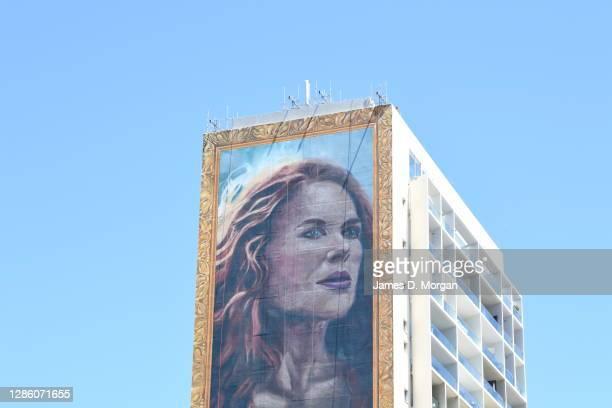 An advertising painting of Australian actress Nicole Kidman is seen on a Sydney building on November 15, 2020 in Sydney, Australia. A team of 11...
