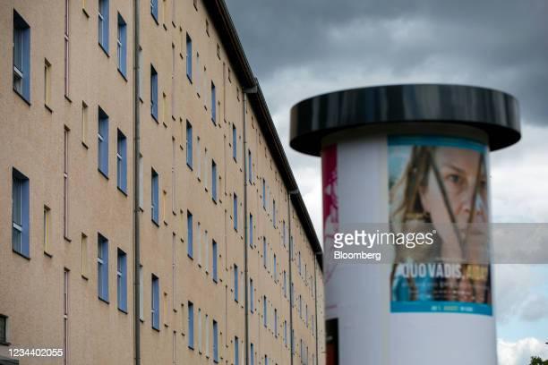 An advertising pillar outside a residential apartment block on the Carl Legien modernist housing estate, operated by Deutsche Wohnen SE, in Berlin,...