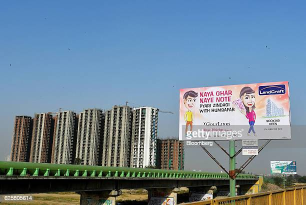 An advertisment for a real estate agency displays a cartoon character holding new Indian two thousand rupee banknotes and words reading 'New House...