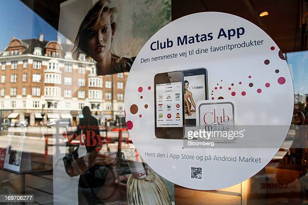 An advertisment for the Club Matas smartphone app sits in the window of a Matas drugstore in Copenhagen Denmark on Friday May 31 2013 CVC Capital...