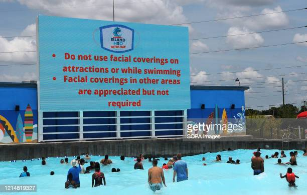 An advisory about face coverings is displayed at the wave pool at Island H2O Live water park as the attraction becomes the only major water park in...