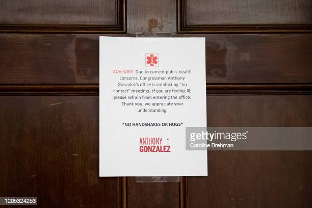 An advisory about physical contact hangs on the door of the office of Rep Anthony Gonzalez ROhio in Washington with recent concerns about the growing...