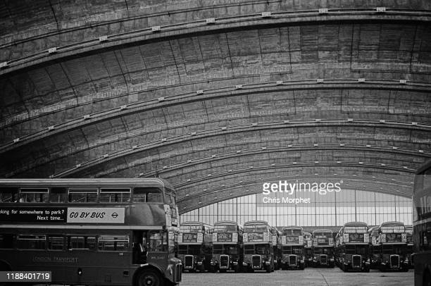An AEC Routemaster doubledecker bus at Stockwell Bus Garage south London 26th February 1967 In the background are Leyland Titans