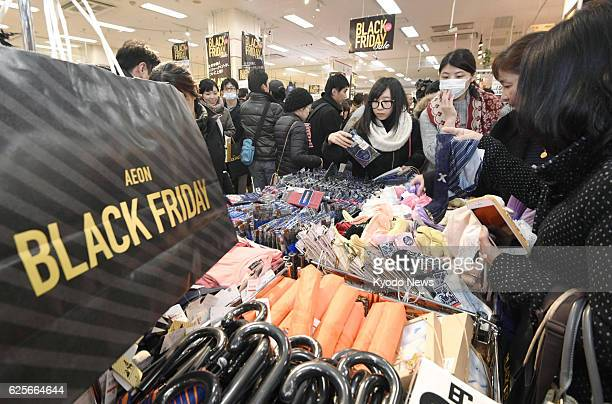 An Aeon grocery store in Tokyo is thronged with customers in the early hours of Nov 25 as the Japanese retail giant introduced the US 'Black Friday'...