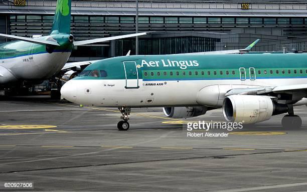 An Aer Lingus Airbus A320 passenger jet aircraft taxis at Dublin Airport in Dublin Ireland