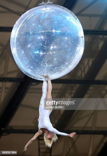 An aerial artist performs at the Stadium Gala of the 2017 Deutsches Turnfest at the Olympic Stadium in Berlin on June 6 2017 / AFP PHOTO / Adam BERRY