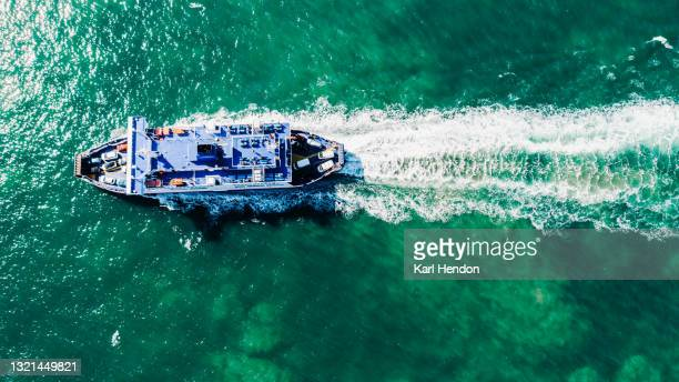 an aerial daytime view of a car ferry on the solent sea, uk - stock photo - portsmouth england stock pictures, royalty-free photos & images