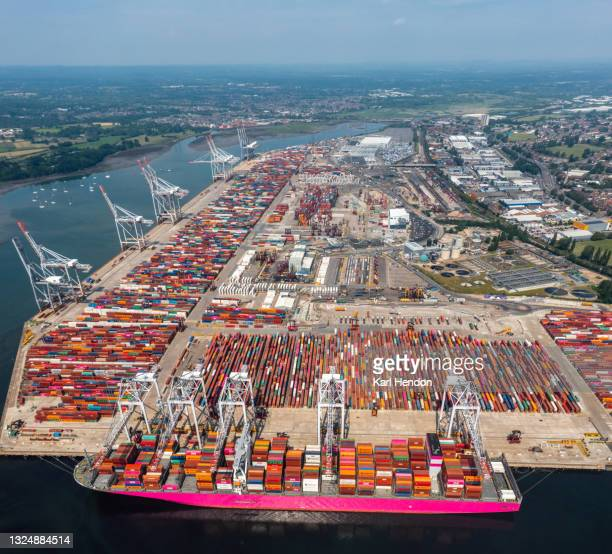 an aerial daytime view of a container ship being loaded in port, uk - stock photo - southampton england stock pictures, royalty-free photos & images