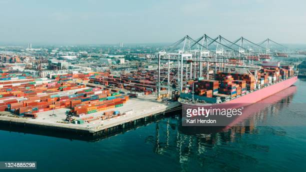 an aerial daytime view of a container ship being loaded in port, uk - southampton england stock pictures, royalty-free photos & images