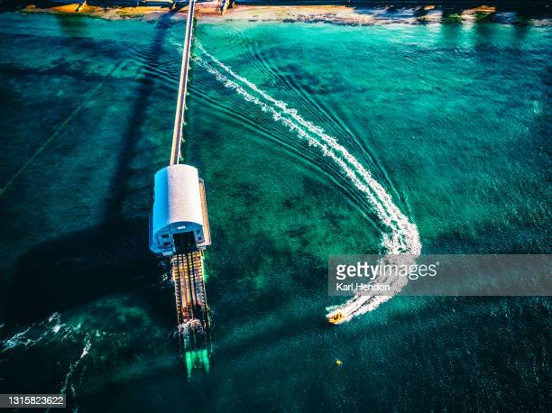 an aerial daytime view of a jetski and a lifeboat station - stock photo - passenger craft stock pictures, royalty-free photos & images