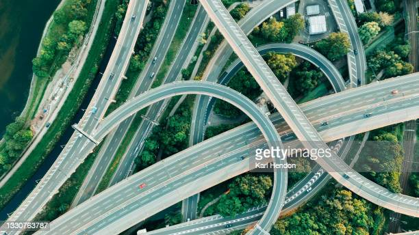 an aerial daytime view of a uk motorway intersection - stock photo - day stock pictures, royalty-free photos & images