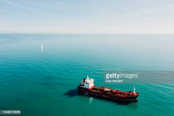 an aerial daytime view of an oil tanker on the solent sea, uk - stock photo - portsmouth england stock pictures, royalty-free photos & images