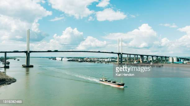 an aerial daytime view of the dartford crossing on a sunny day - stock photo - drone point of view stock pictures, royalty-free photos & images