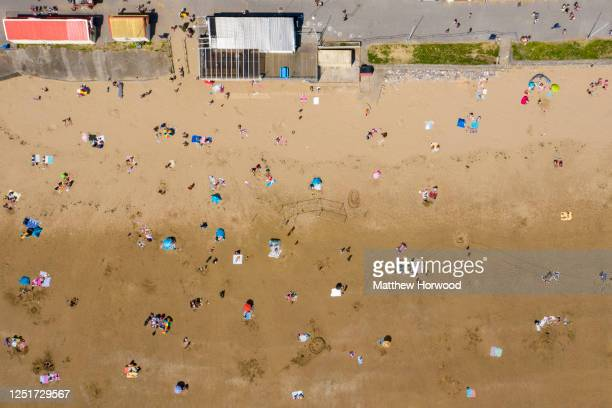 An aerial drone camera view of Sandy Bay beach as the Met Office warn temperatures could reach 34 degrees this week on June 24, 2020 in Porthcawl,...