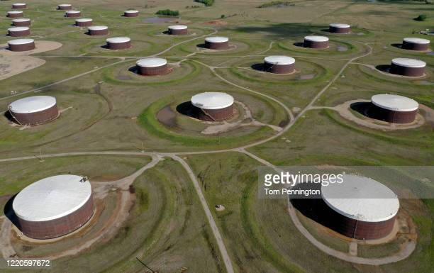 An aerial drone view of a crude oil storage facility on April 23, 2020 in Cushing, Oklahoma. Crude oil prices plummeted into negative territory this...
