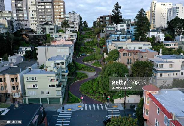 An aerial drone view of an empty Lombard Street tourist destination during the coronavirus pandemic on March 30, 2020 in San Francisco, California....