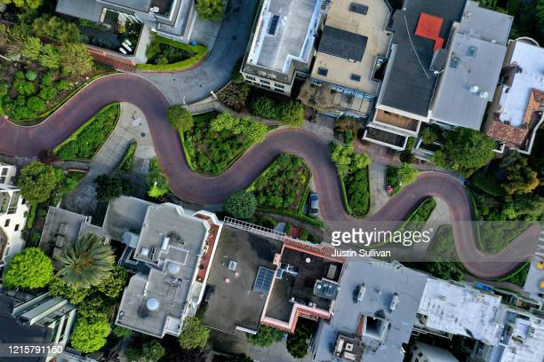 An aerial drone view of an empty Lombard Street tourist destination during the coronavirus pandemic on March 30 2020 in San Francisco California...