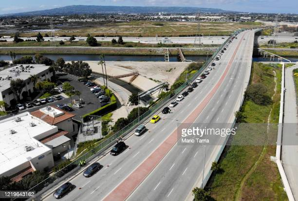 An aerial drone view of cars lined up to receive food distributed by the Los Angeles Regional Food Bank amidst the coronavirus pandemic on April 18...
