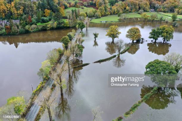 An aerial drone view of flooded fields as the River Conwy bursts its banks on October 30, 2020 in Llanrwst, Wales. Authorities have issued yellow...