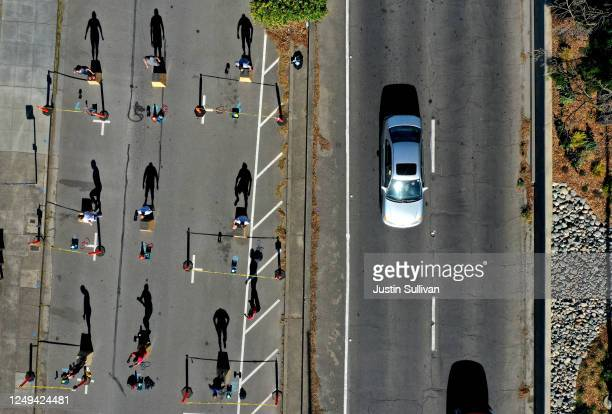 An aerial drone view of members of Ross Valley Fitness as they participate in an outdoor socially distanced workout class on June 13 2020 in San...
