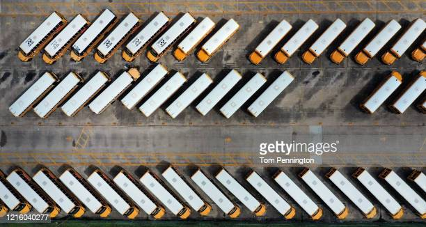 An aerial drone view of school buses parked at Fort Worth Independent School District transportation headquarters on March 31 2020 in Fort Worth...