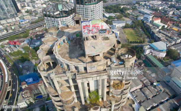 An aerial drone view of the Sathorn Unique Tower or Ghost Tower in Bangkok It is a derelict building due to the 1997 Asian financial crisis