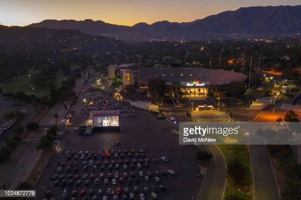 An aerial drone view shows a temporary drivein movie theater at the Rose Bowl stadium known for its spectacular Fourth of July fireworks which were...