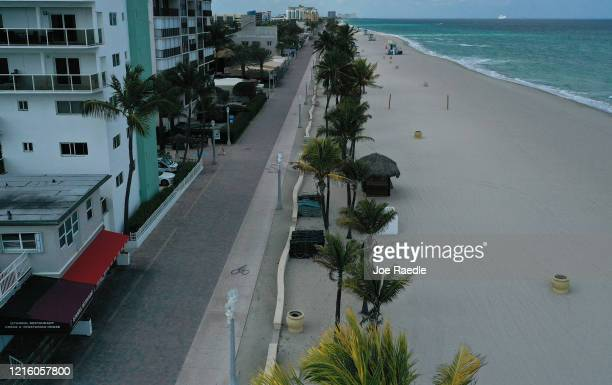 An aerial drone view shows the empty boardwalk on March 31 2020 in Hollywood Florida The City of Hollywood along with other cities along the...