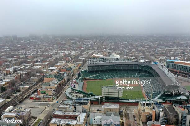 An aerial from a drone shows Wrigley Field, home of the Chicago Cubs, which, like all Major League Baseball parks sits nearly empty on what was to be...