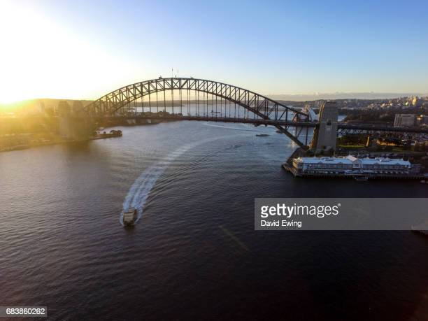 an aerial image of the sydney harbour bridge. - david ewing stock pictures, royalty-free photos & images