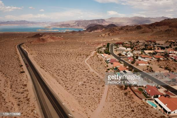 An aerial image shows homes in Bolder City, right, and Lake Mead on the Colorado River, left, during low water levels due to the western drought on...