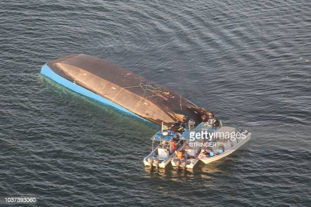 An aerial image shows the capsized ferry MV Nyerere which killed 131 people in Lake Victoria Tanzania on September 21 2018 Tanzanian President John...