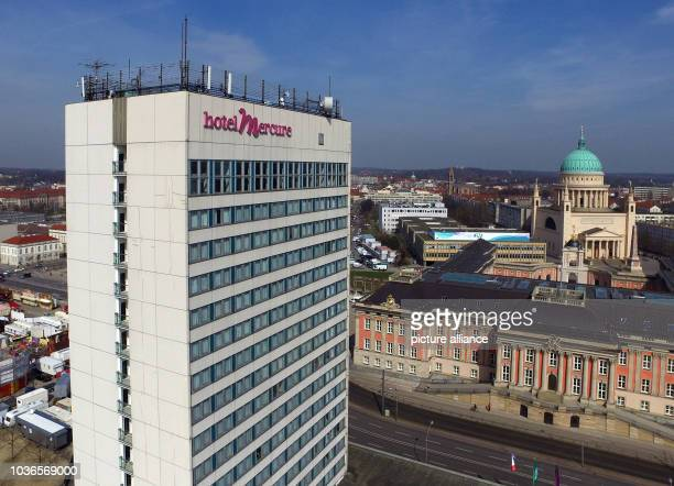 An aerial image taken by a drone shows Hotel Mercure in Potsdam, Germany, 05 April 2016, with the city castle and the St. Nicholas' Church pictured...