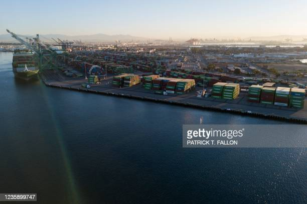 An aerial image taken on October 15, 2021 shows cargo shipping containers at the Port of Los Angeles in San Pedro, California. - The port, North...