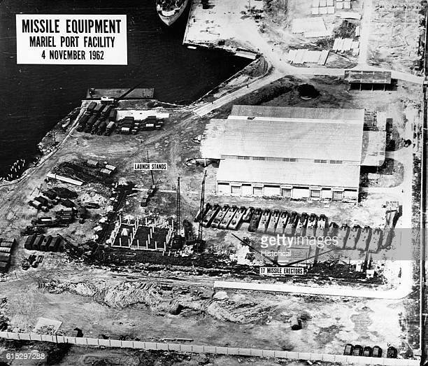 An aerial intelligence photograph of missile erectors and launch stands at the Mariel Port Facility in Cuba during the Cuban Missile Crisis. November...