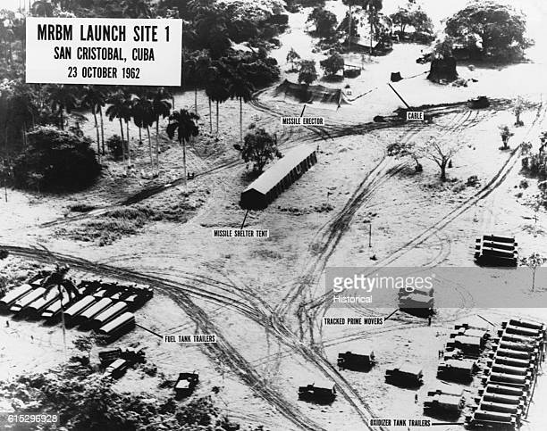 An aerial intelligence photograph of MRBM Launch Site 1 in San Cristobal Cuba showing missile erectors fuel tank trailers and oxidizer tank trailers...