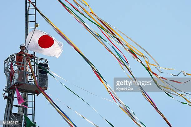 An aerial ladder unit performs a demonstration during the New Year's fire review conducted by the Tokyo Fire Department at Tokyo Big Sight on January...
