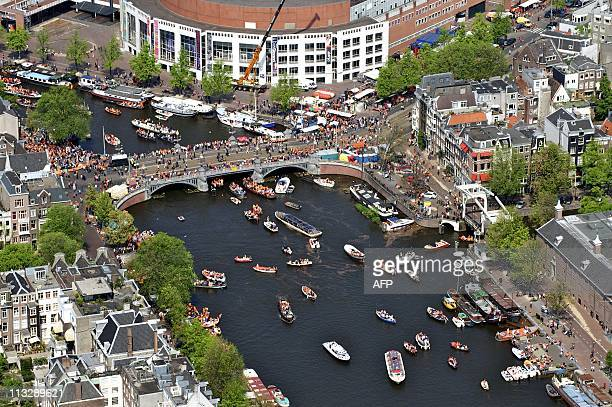 An aerial of Amsterdam shows the crowd gathering during Queensday on April 30 2011 in Amsterdam AFP PHOTO / ANP / BRAM VAN DE BIEZEN netherlands out...
