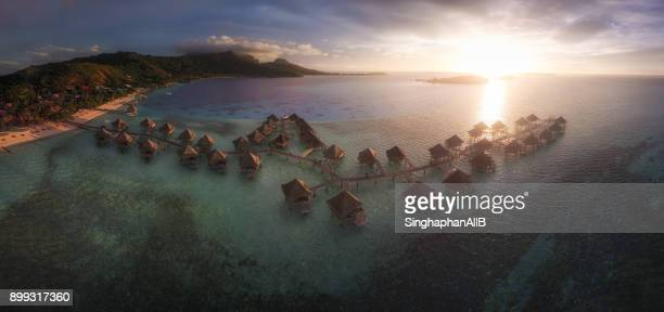 An aerial panorama view of bungalows at the sunset time in Borabora, French Polynesia
