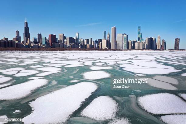 An aerial photo made using a drone shows ice formed along the shoreline of Lake Michigan near downtown as temperatures remained in the low teens on...