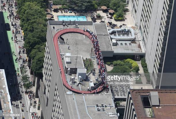 An aerial photo of fans as they gather on a rooftop overlooking Nathan Phillips Square as they turn out for the Toronto Raptors NBA Championship...