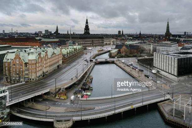 An aerial photo of the Danish Parliament area with empty streets taken at rush hour peak hour during the coronavirus precautions in Copenhagen...