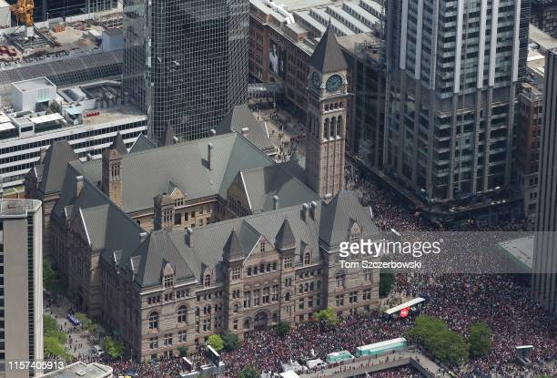 An aerial photo of the old city hall as fans gather at Nathan Phillips Square for the Toronto Raptors NBA Championship Victory Parade after defeating...
