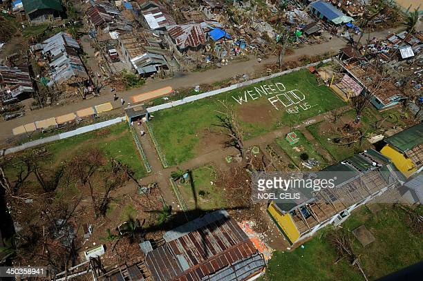An aerial photo shows a message that reads 'We Need Food Help Us' amongst the devastation in the aftermath of typhoon Haiyan in Ormoc on the eastern...