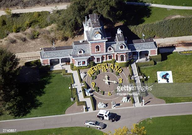 An aerial photo shows a Santa Barbara County Sheriff's vehicle in front of singer Michael Jackson's Neverland Ranch November 18 2003 outside of Santa...