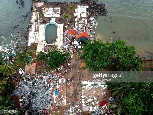 TOPSHOT An aerial photo shows damaged buildings in Carita on December 23 after the area was hit by a tsunami on December 22 following an eruption of...