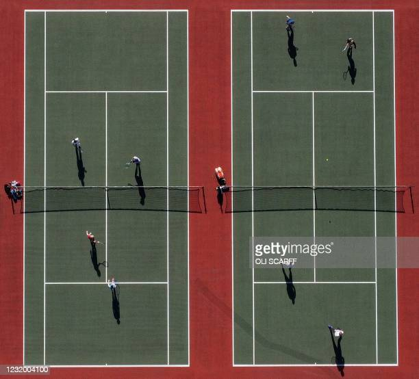 An aerial photo shows people playing tennis at the Mersey Bowman Lawn Tennis Club in Liverpool northwest England on March 29 as England's third...